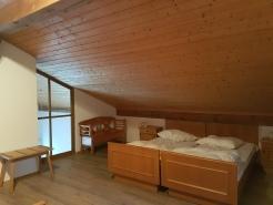Betten in verglaster Galerie oben
